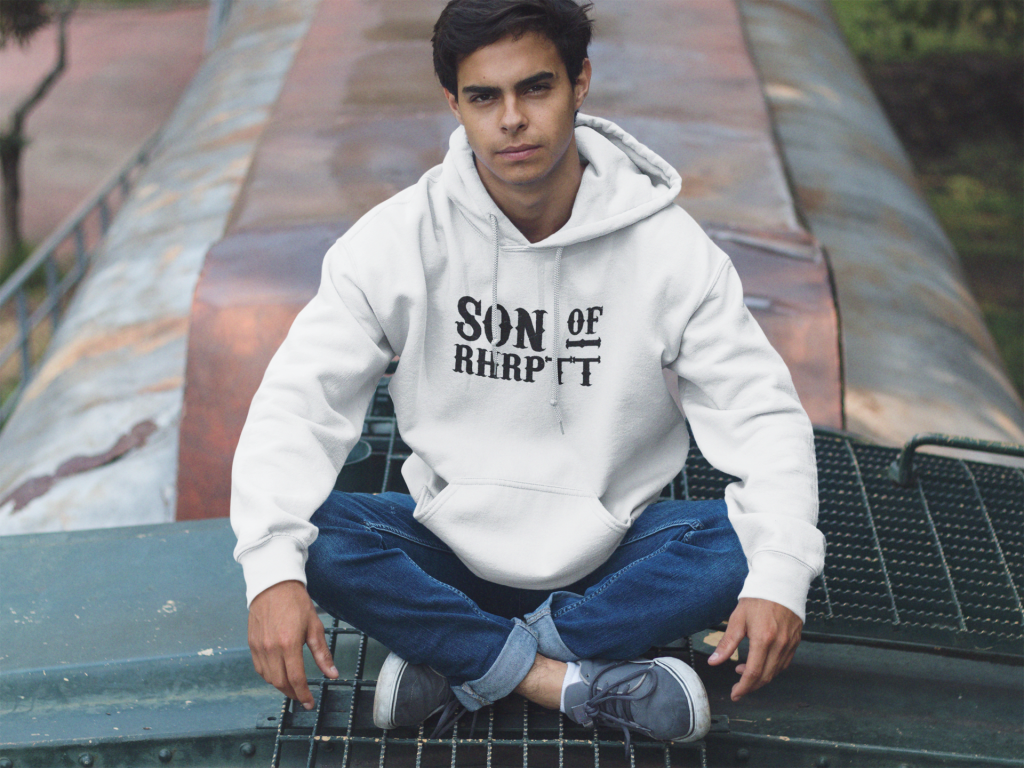 young man sitting cross legged on a train pullover hoodie mockup a12497 2 RHRPTT heisst Ruhrpott